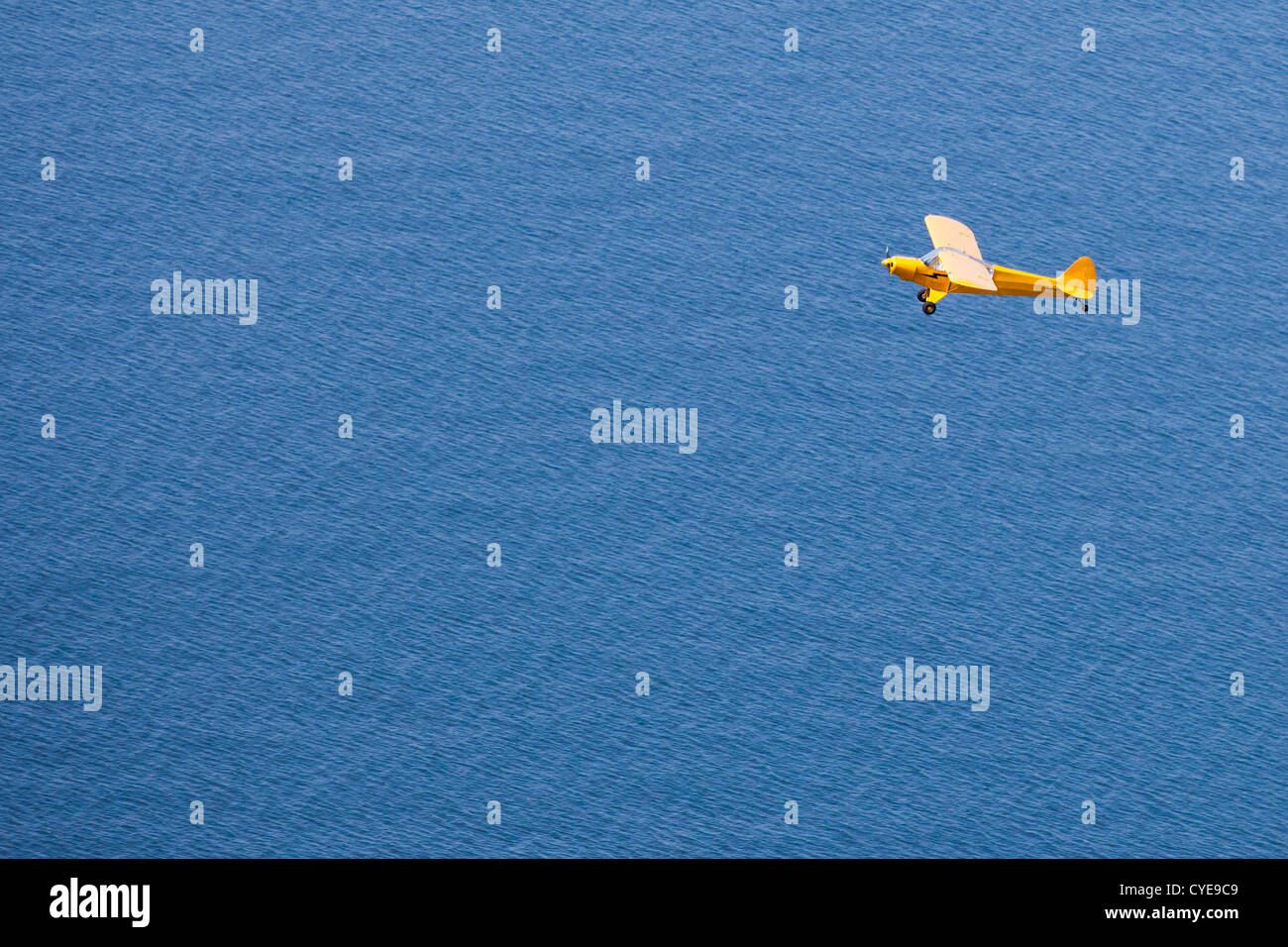 The Netherlands, Scheveningen, The Hague or in Dutch: Den Haag. Small airplane, a Piper Cub, flying over the North - Stock Image
