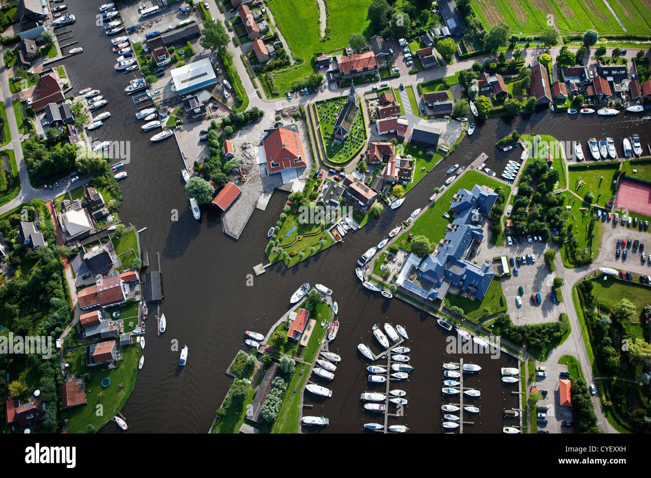 The Netherlands, Uitwellingerga, Aerial. Center of village and marina. - Stock Image