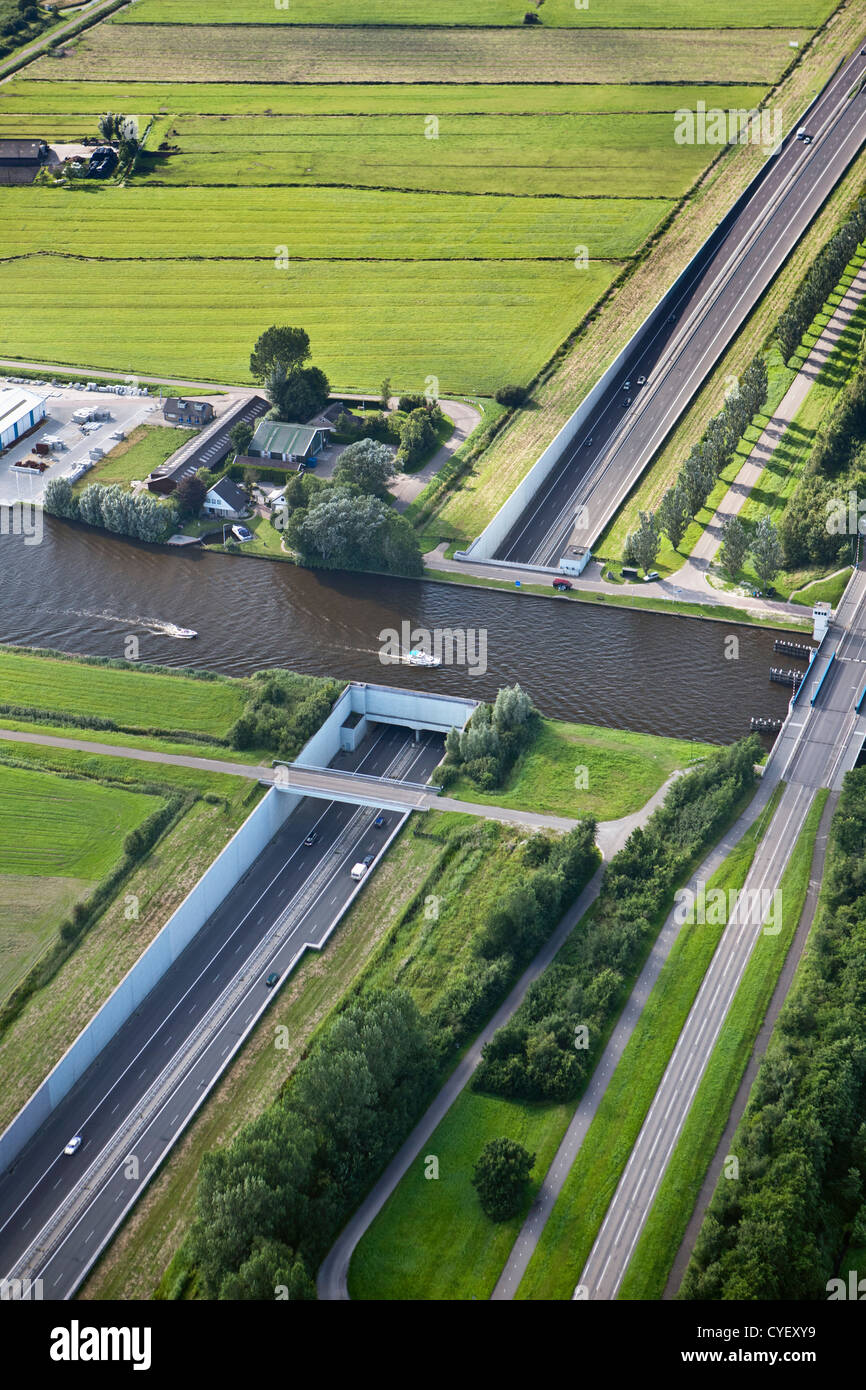 The Netherlands, Uitwellingerga, Aerial. Aquaduct over A7 highway. - Stock Image