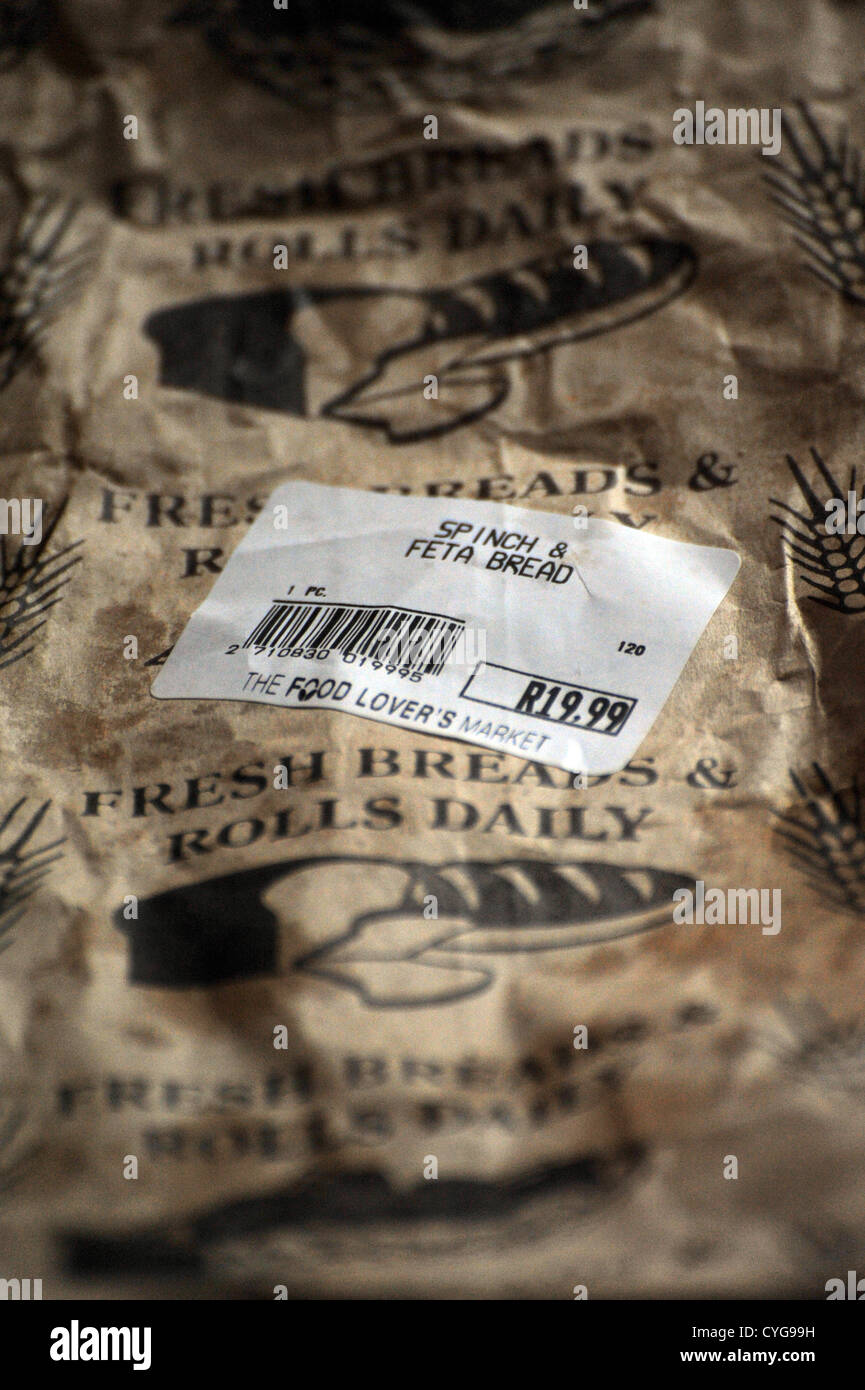 Food label on a brown paper bag containing Spinach and Feta bread - Stock Image