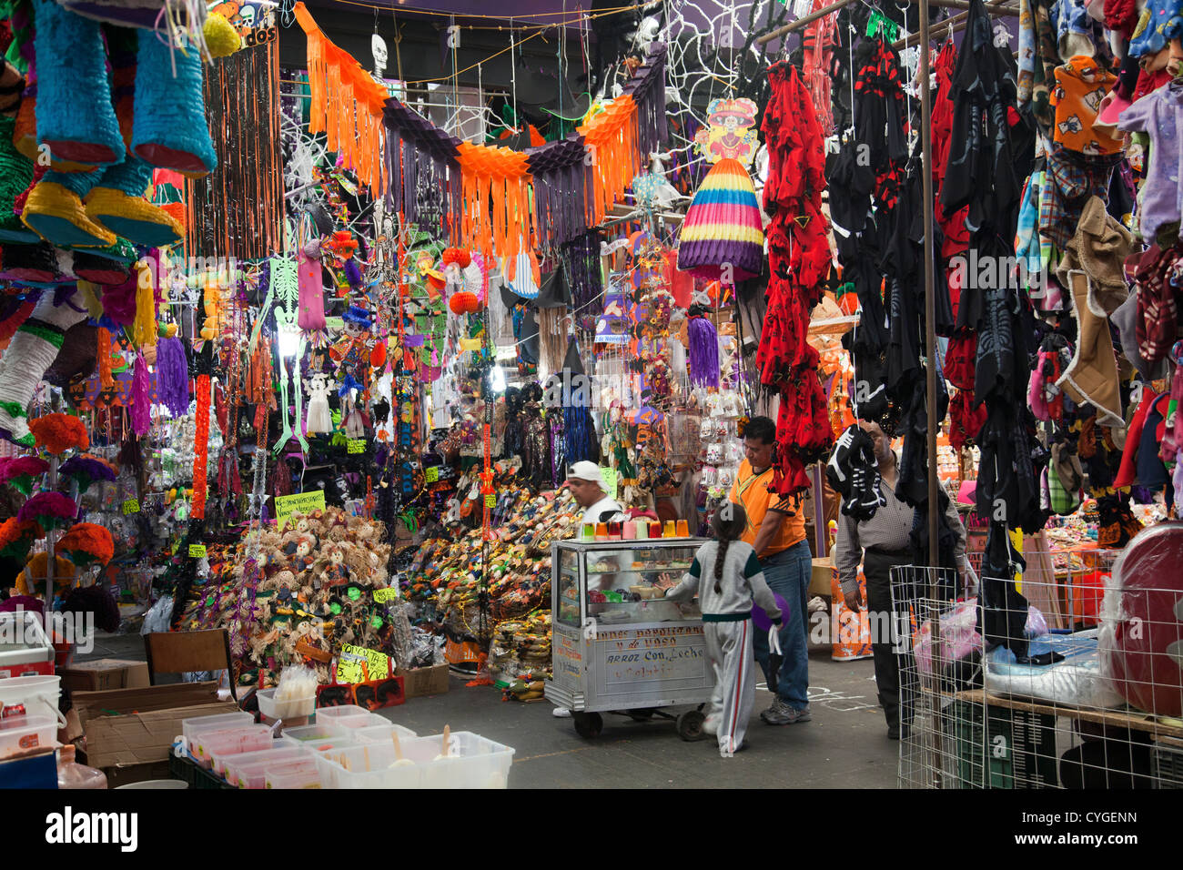 merchandise for halloween and da de los muertos at a stall in jamaica market in mexico city df