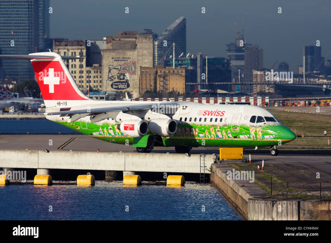 Regional airliner Swiss International Air Lines BAE Systems Avro 146-RJ100 at London City Airport, England, UK Stock Photo