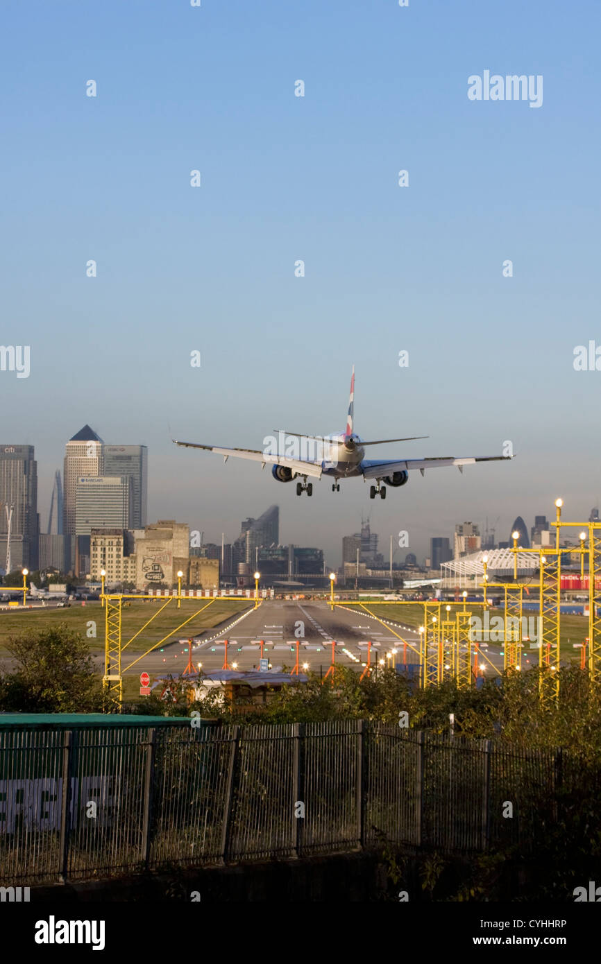 British Airways regional airliner landing at London City Airport, England, UK - Stock Image