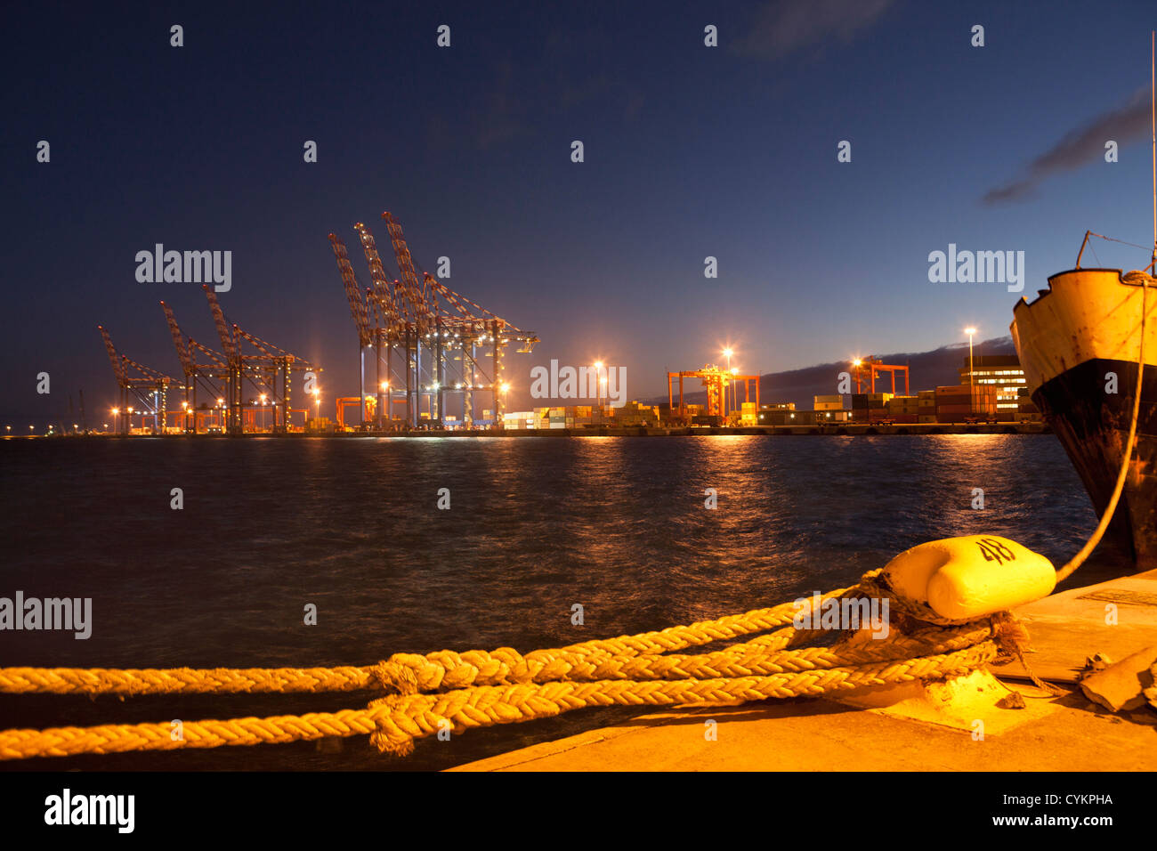 Rope docking ship in shipyard - Stock Image