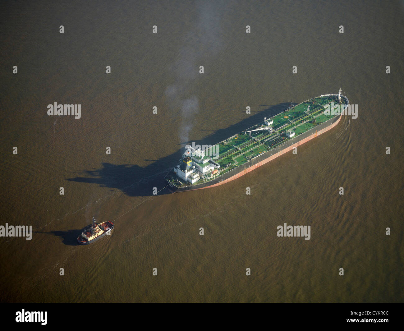 Ship entering Liverpool Docks at the mouth of the River Mersey, North West England, UK - Stock Image