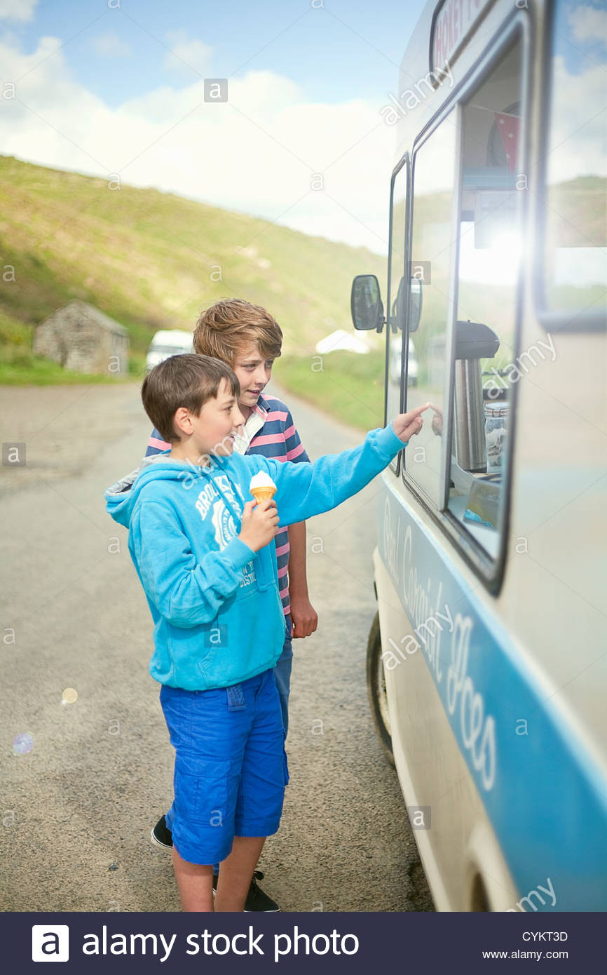 Boys buying ice cream from truck - Stock Image