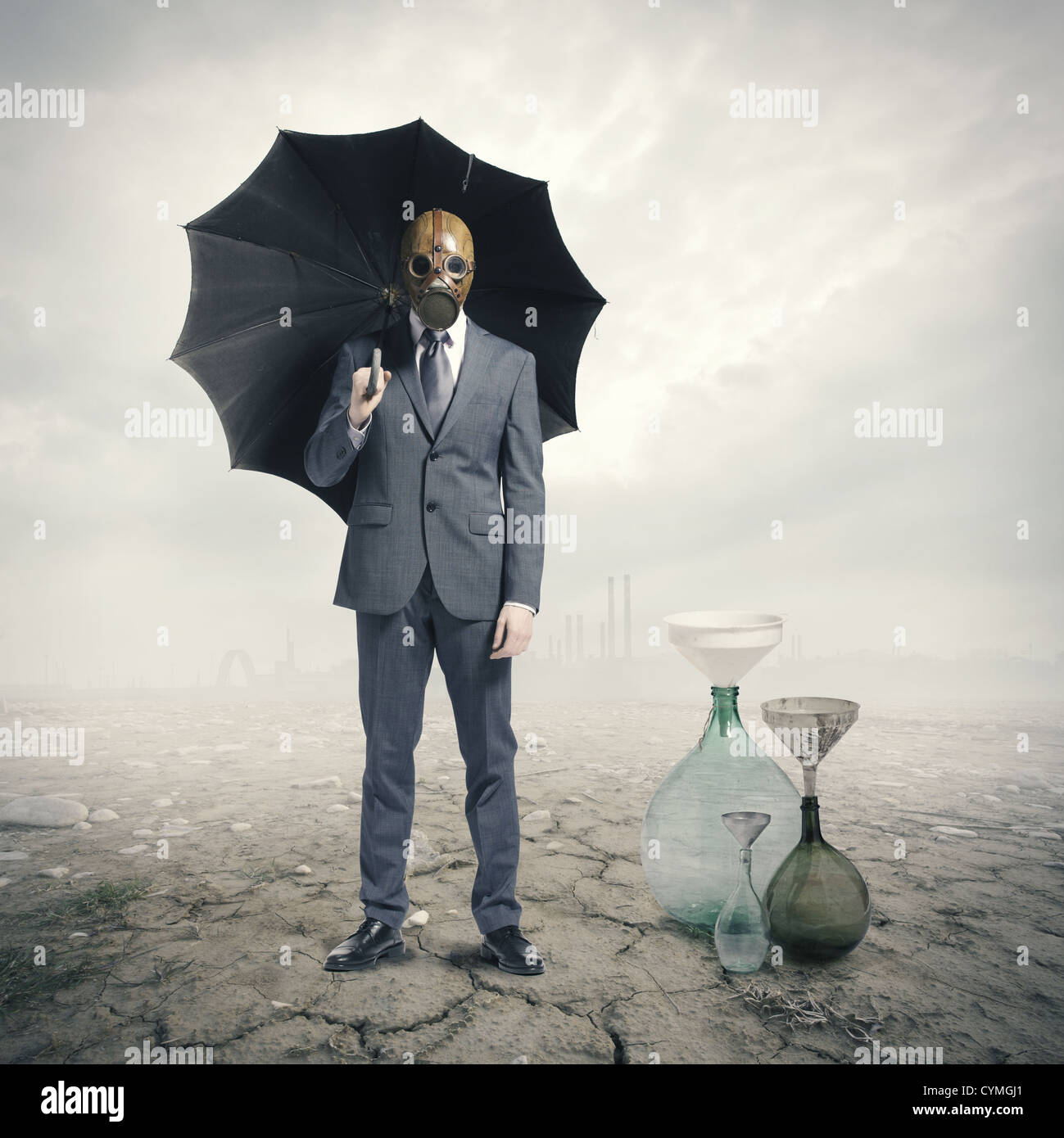 Global Warming:Businessman waiting for the rain - Stock Image