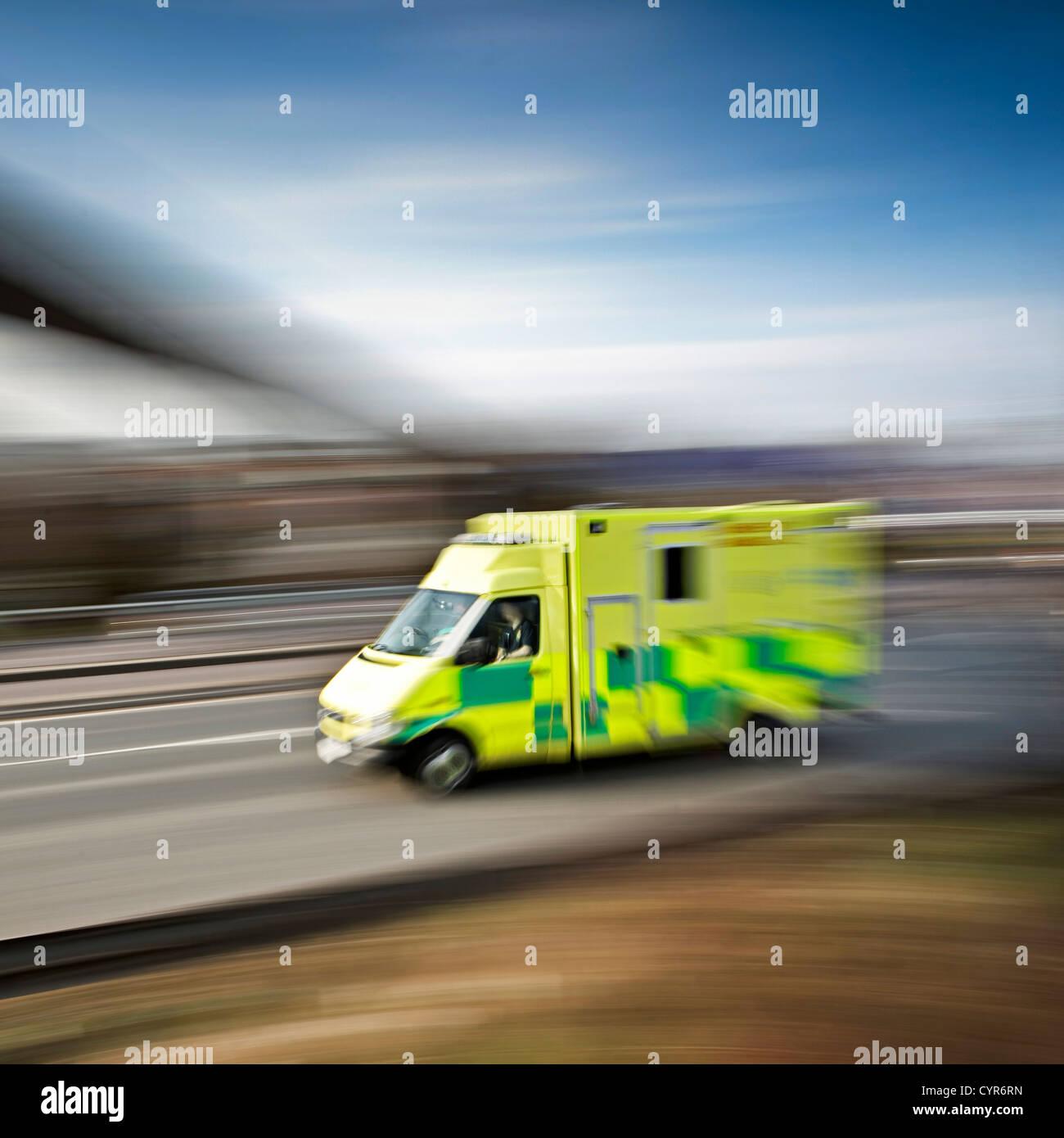 ambulance emergency response speeding along the motorway - Stock Image