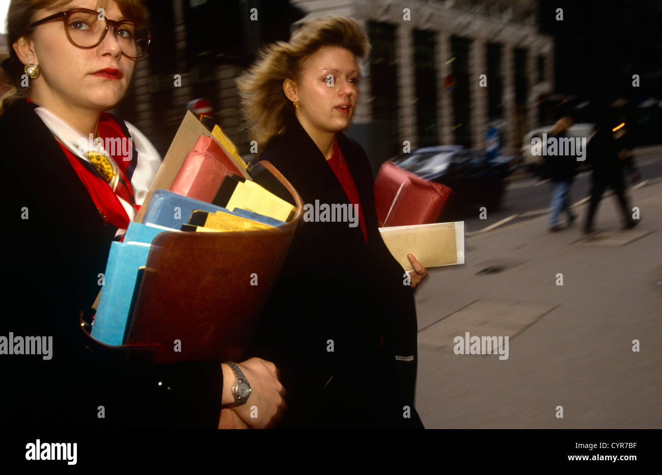 women-office-workers-dash-through-a-city