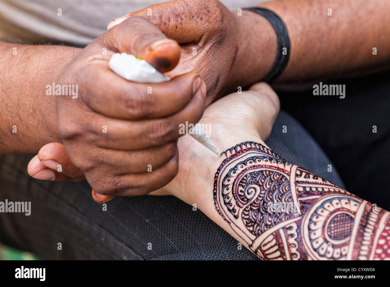 India Uttarakhand Rishikesh Man Drawing Henna Tattoo On Woman