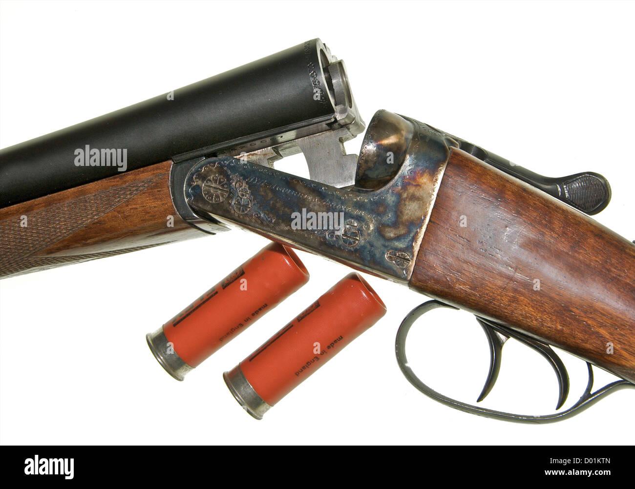 Shotgun 12 gauge bore shotgun This is an AYA No 4 Boxlock side-by-side double barreled gun 'broken' to insert - Stock Image