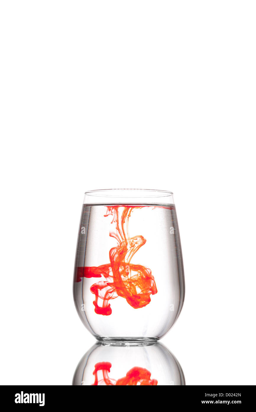 A Clean Clear Glass Of Water With A Drop Of Red Food Coloring Stock