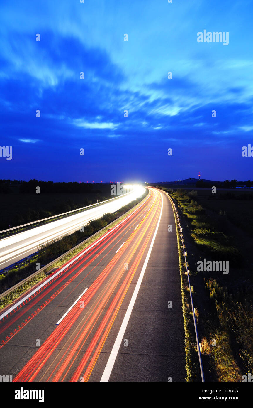 night traffic motion blur on highway showing car or transportation concept - Stock Image