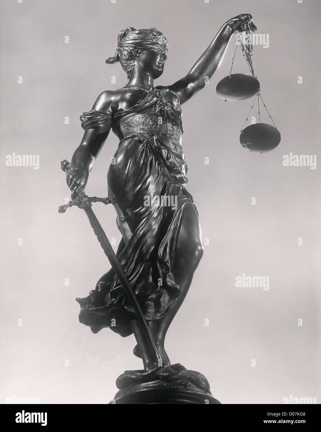 Lady Justice Sculpture of woman w/ithsword and scale - Stock Image