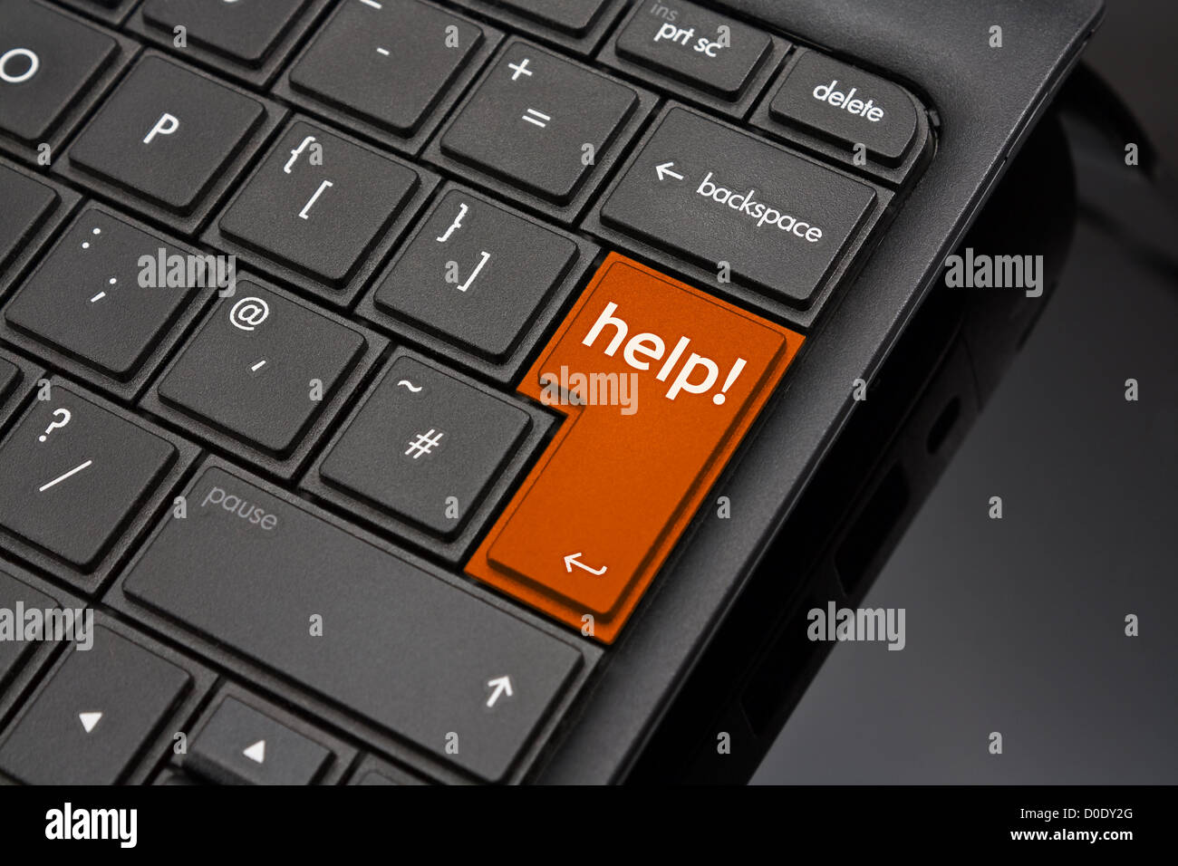 Help Return Key symbolizing a user requesting support to help repair a crashed or damaged computer - Stock Image
