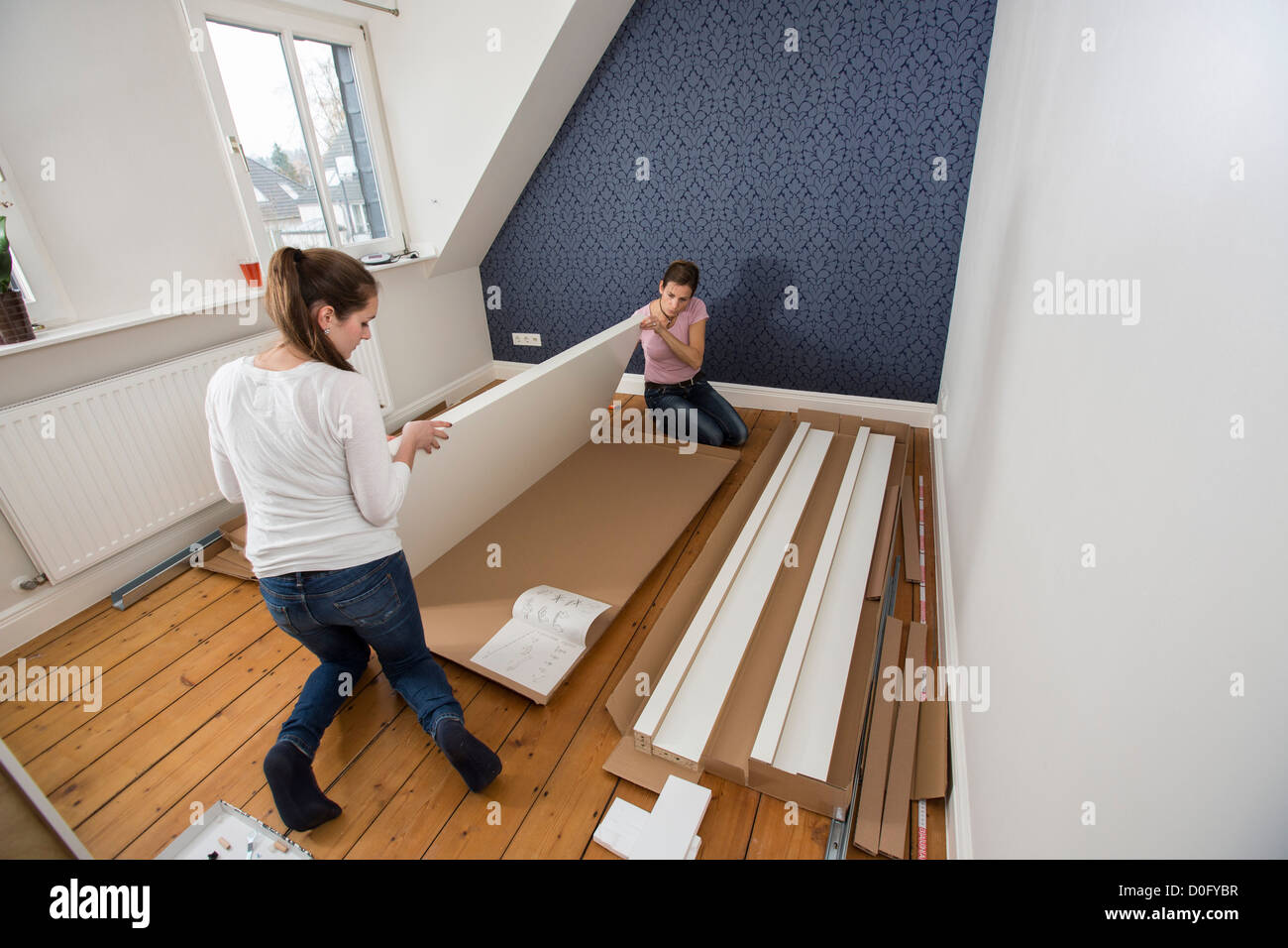 Mother and daughter assemble furniture bed do it yourself home mother and daughter assemble furniture bed do it yourself home improvement solutioingenieria Images