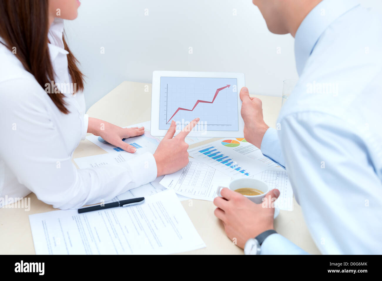 Business people discussing about the success sales and using a digital computer. - Stock Image