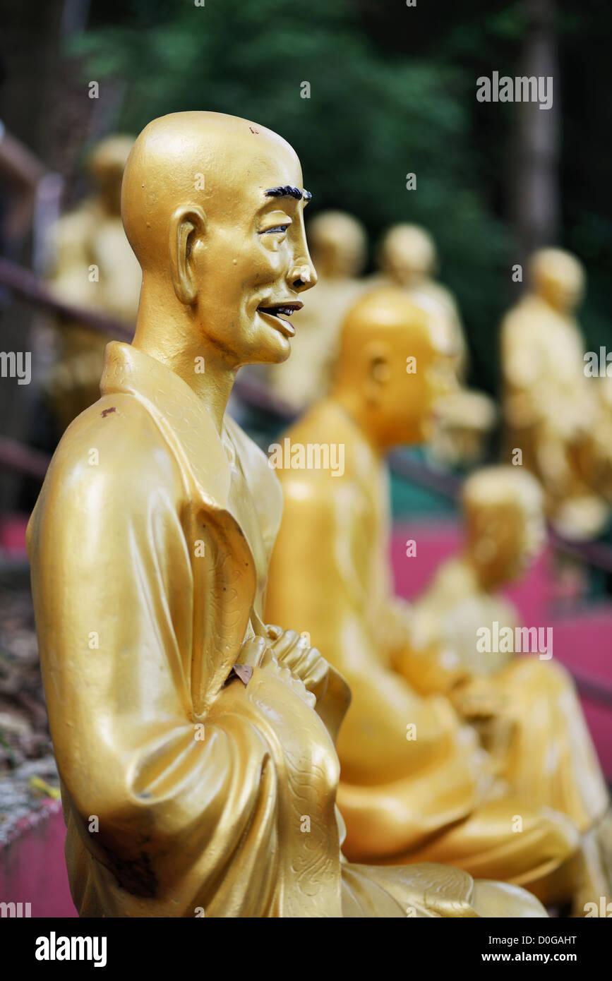 Statues sat Ten Thousand Buddhas Monastery in Sha Tin, Hong Kong, China. - Stock Image