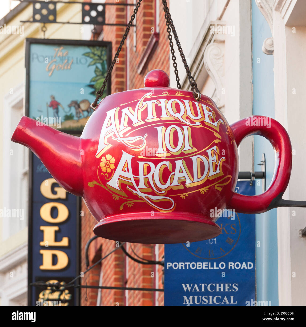 London, Portobello Road, Notting Hill. Big red teapot shop sign for antiques mall the Antique 101 Arcade on Portobello - Stock Image