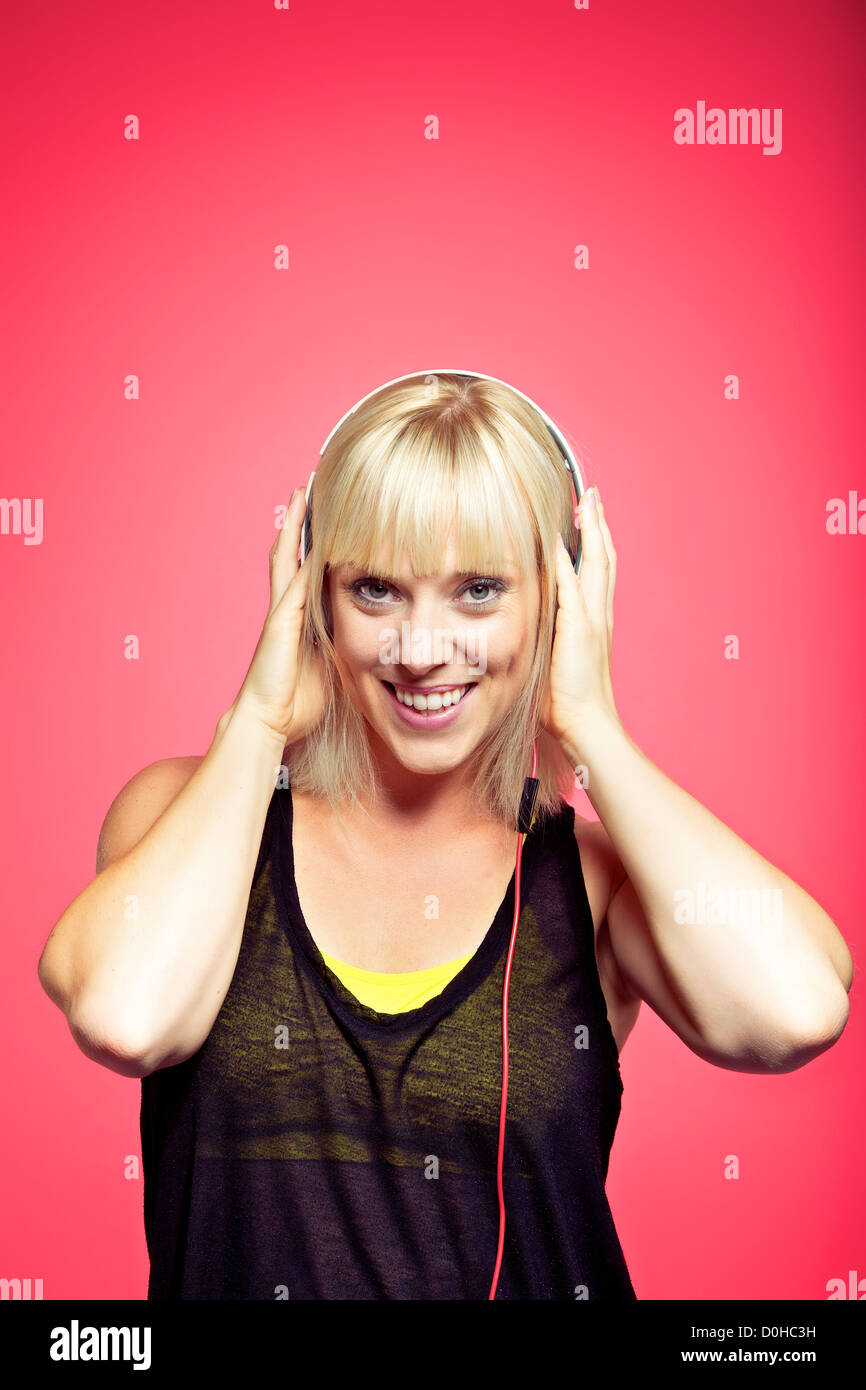 Stylish teen in a studio having fun while listening to the beat of modern music - Stock Image