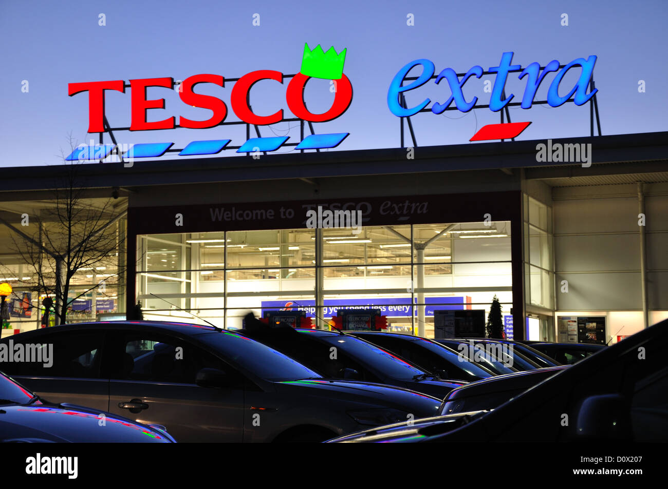 Tesco neon sign showing its green christmas hat Stock Photo
