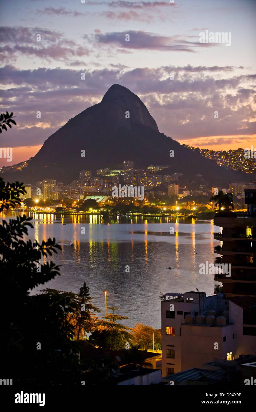 City lights, Lagoa and Morro Dois Irmaos, Rio de Janeiro, Brazil - Stock Image