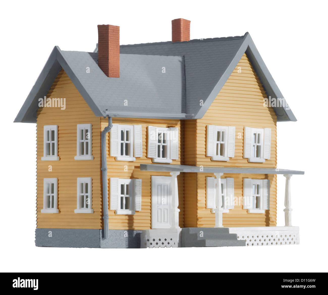 Gray and yellow miniature farm house - Stock Image