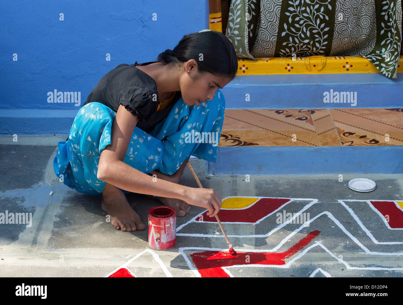 Teenage Indian Village Girl Painting Out A Rangoli Design Outside