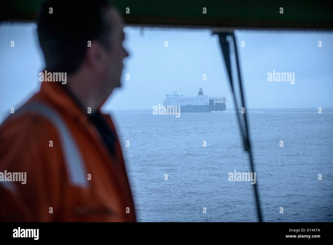Tanker ship seen from tugboat - Stock Image