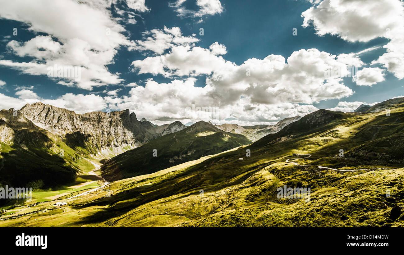 Clouds over grassy rural landscape - Stock Image