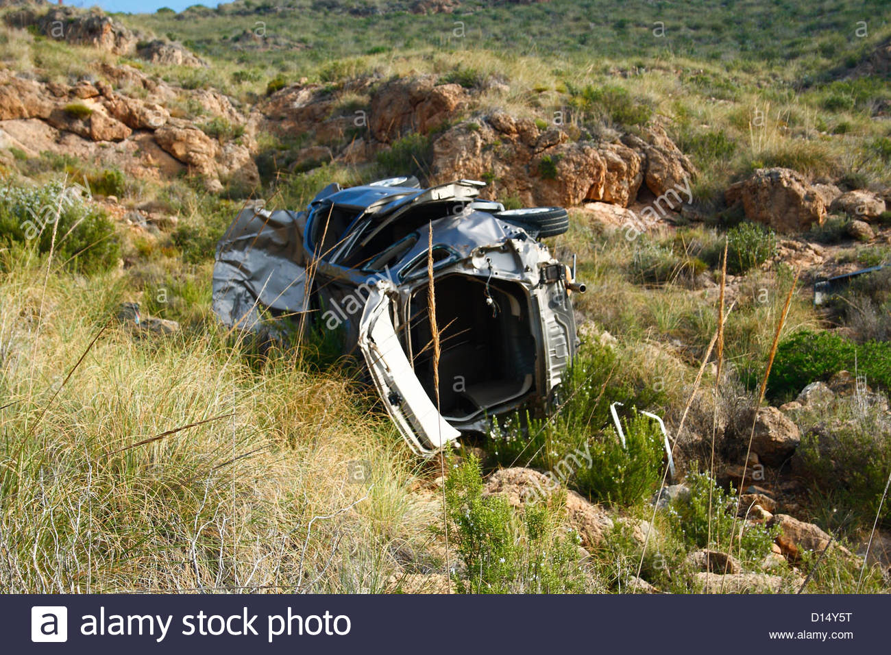 Crashed car in a cliff - Stock Image