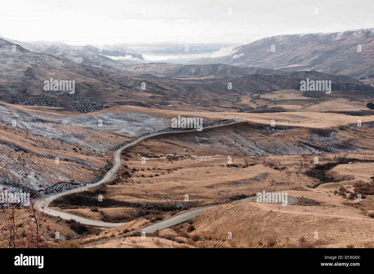 Curved road in rural landscape - Stock Image