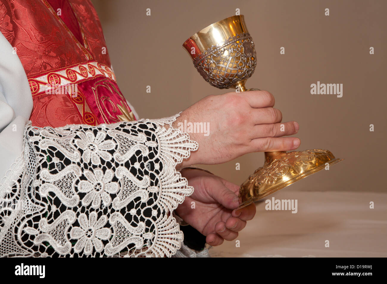 hands of priest by the mass and the cap - Stock Image