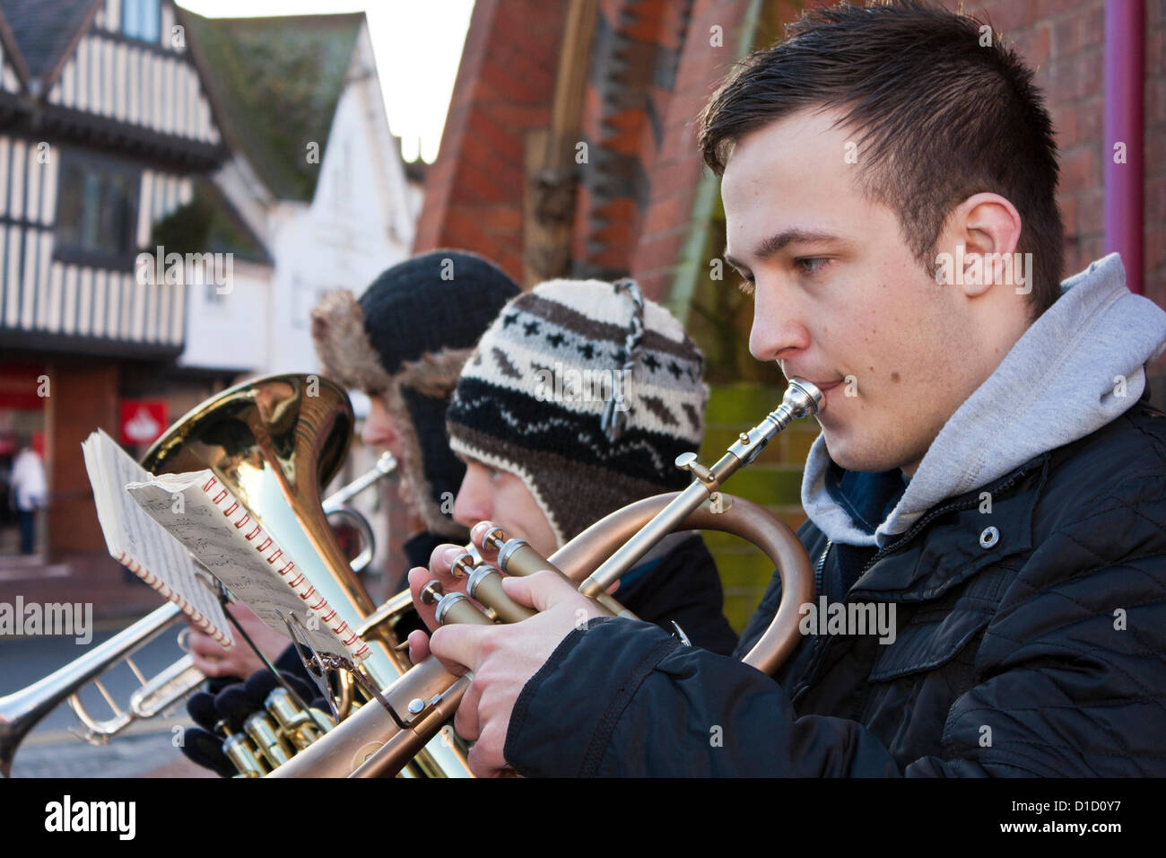 Street musicians play Christmas Carols outside Wokingham Town Hall in Berkshire, England. Stock Photo