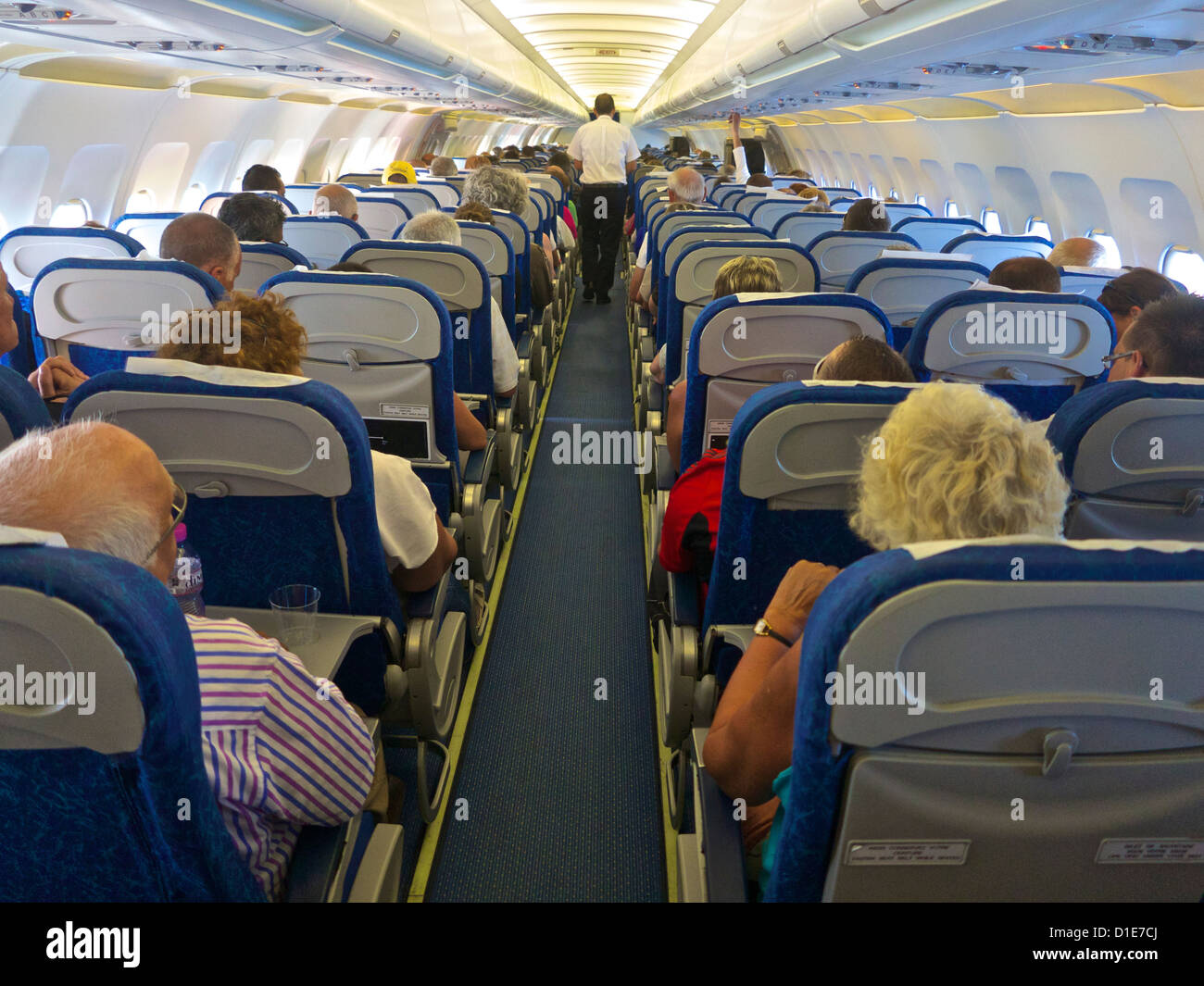 Airbus A320 plane inside cabin with passengers, France, Europe - Stock Image