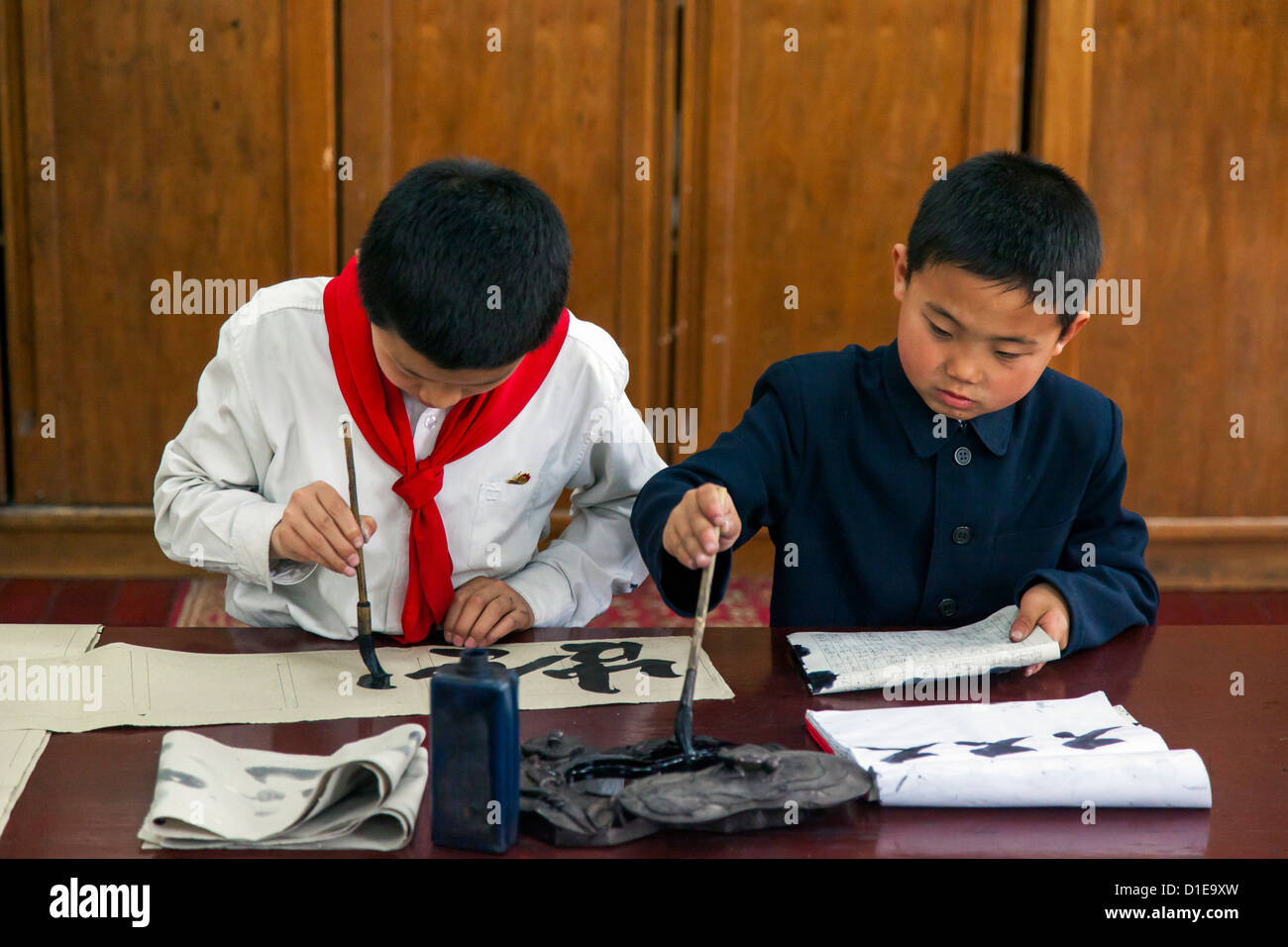 Calligraphy class, Mangyongdae Schoolchildren's Palace, Pyongyang, Democratic People's Republic of Korea - Stock Image