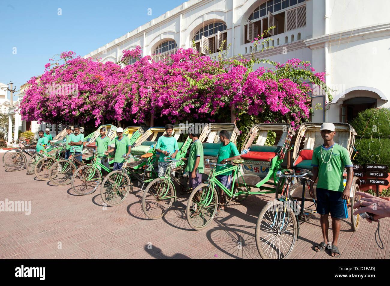 Green riders, cycle rickshaw wallahs encouraging environmentally friendly travel around Puri, Orissa, India - Stock Image