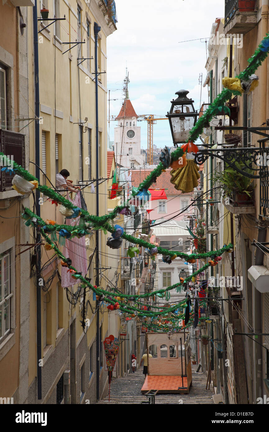 An alley is decorated with tinsel and colour for the annual Festival of St. Anthony in the Bica district of Lisbon, - Stock Image