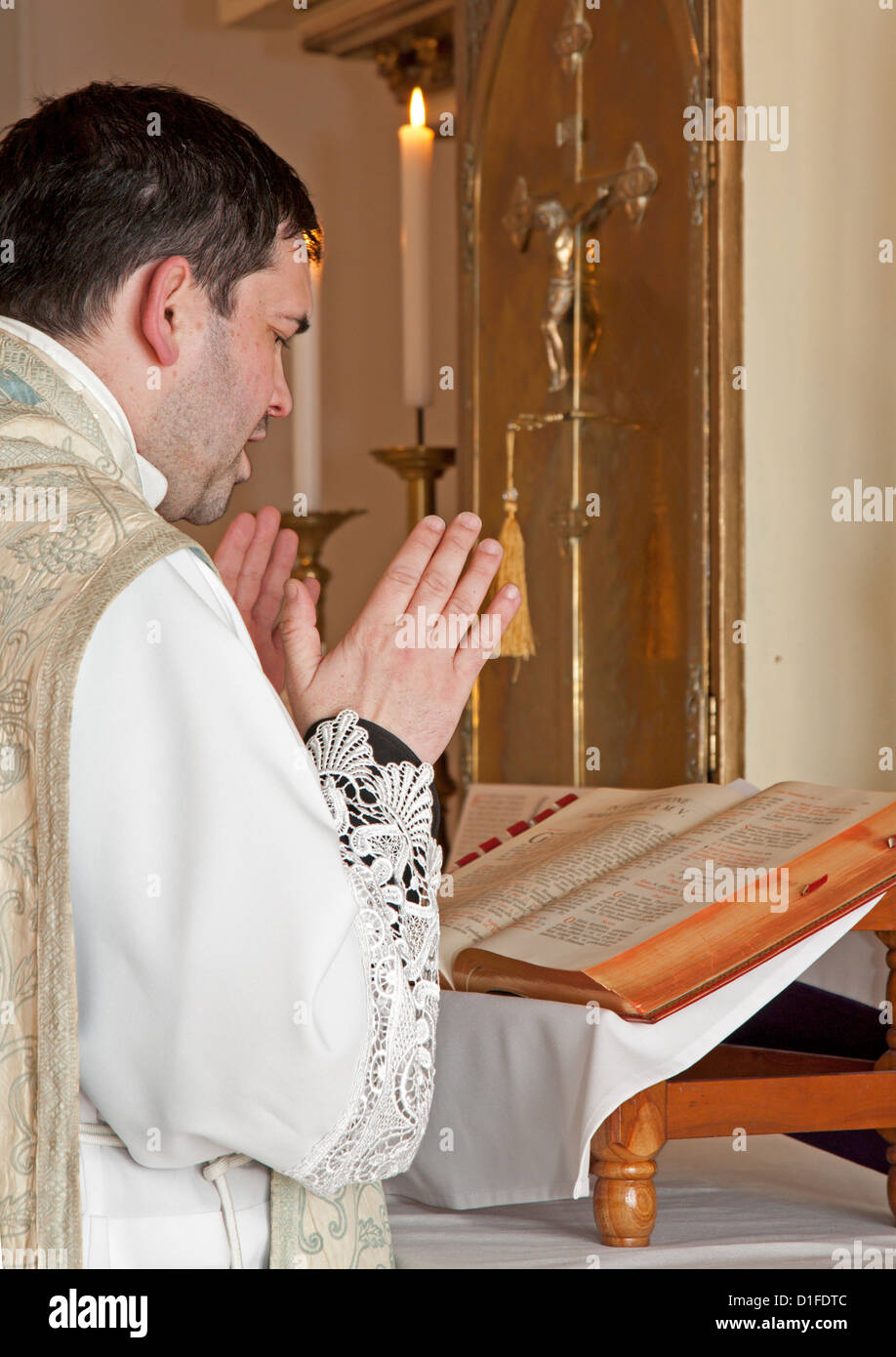 catholic priest at tridentine mass - Stock Image