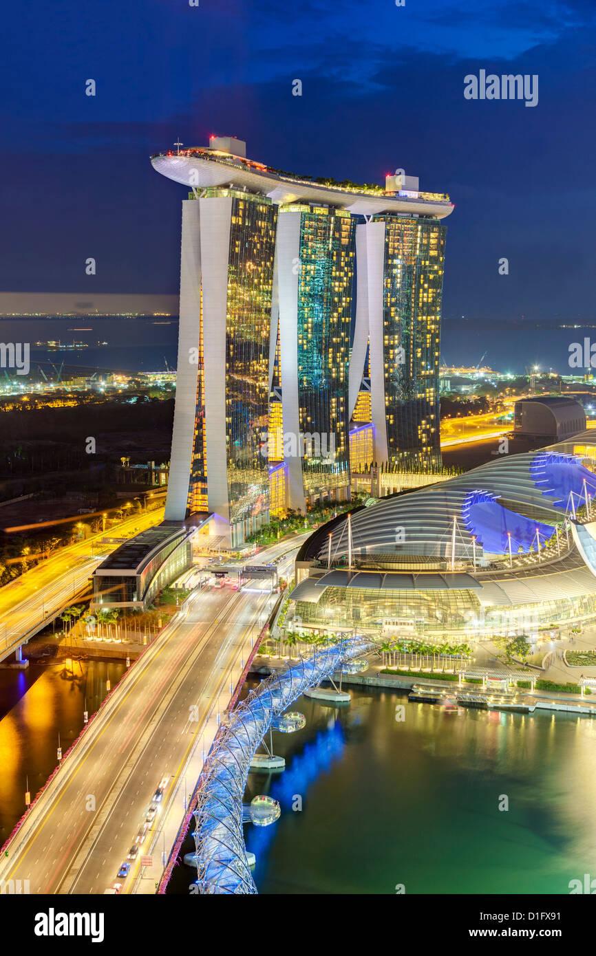 The Helix Bridge and Marina Bay Sands Singapore at night, Marina Bay, Singapore, Southeast Asia, Asia - Stock Image