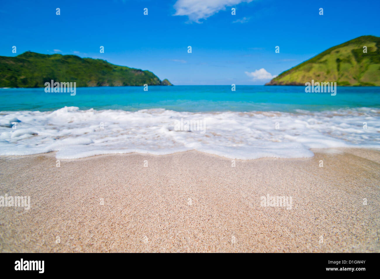 White sands, blue sea and blue sky at Mawun Beach in the South of Lombok, Indonesia, Southeast Asia, Asia - Stock Image