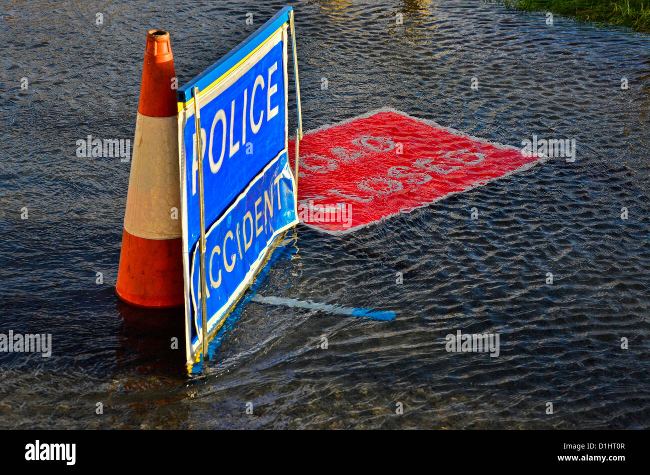 Temporary signs blue Police accident and red road closed Stock Photo