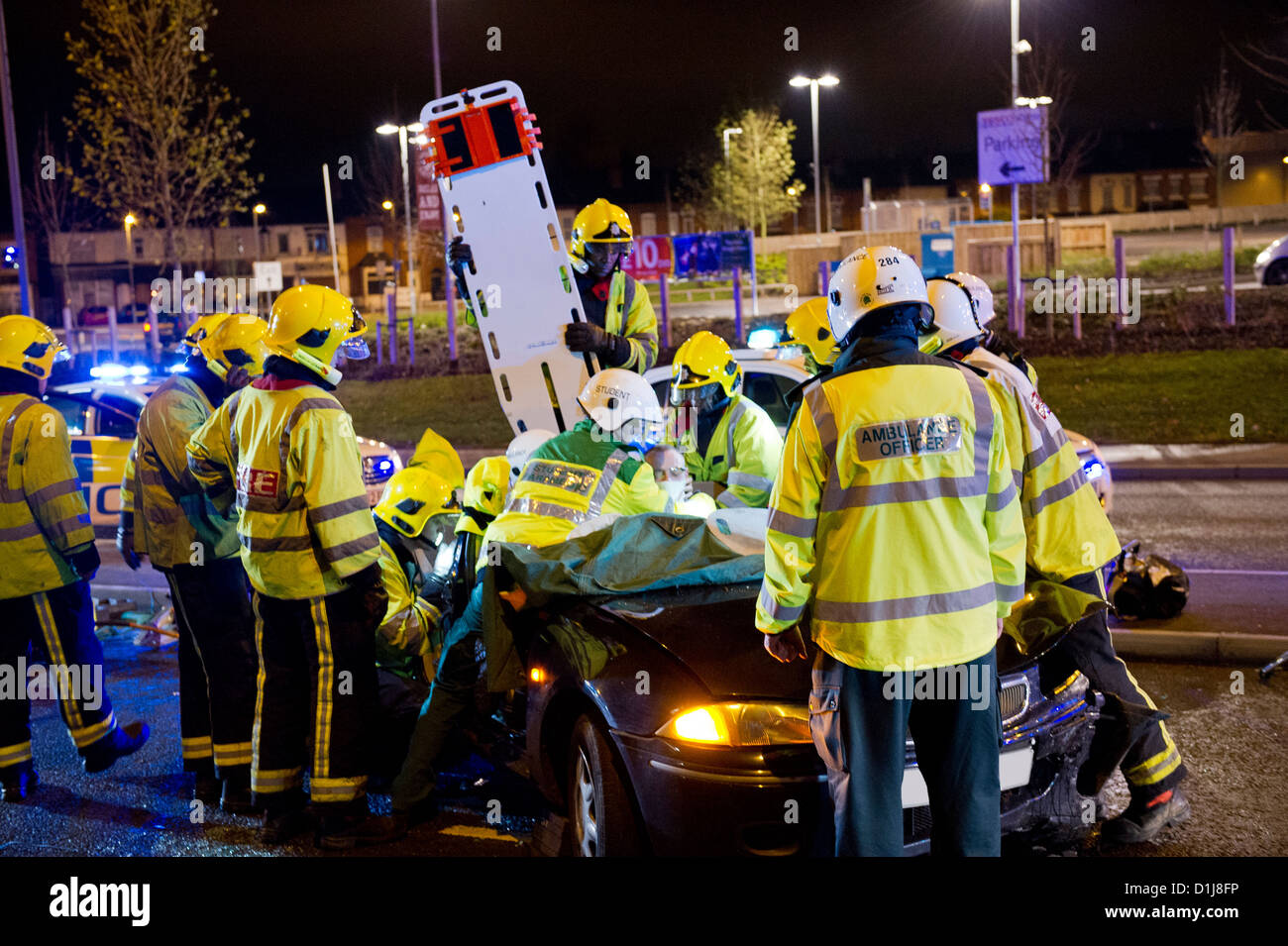 Rescue services attend a two car night time accident Church Rd Yardley Birmingham UK - Stock Image