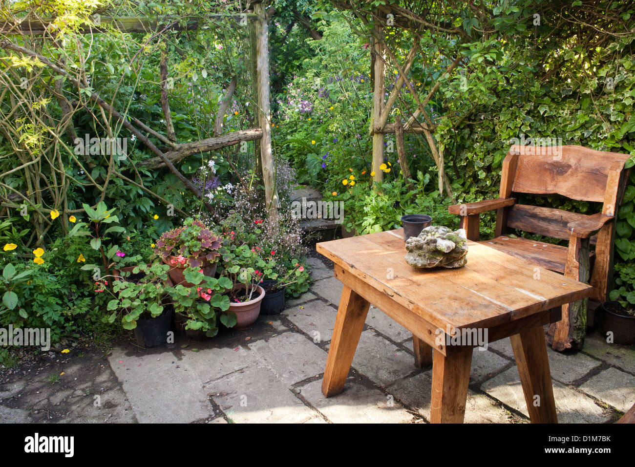 Relaxing area on a patio with rustic garden furniture