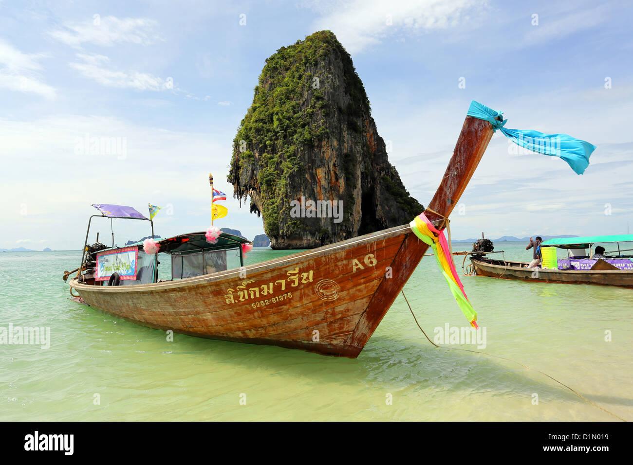 Traditional Thai long tail boat at Phranang Cave Beach, Railay Beach, Krabi, Phuket, Thailand - Stock Image
