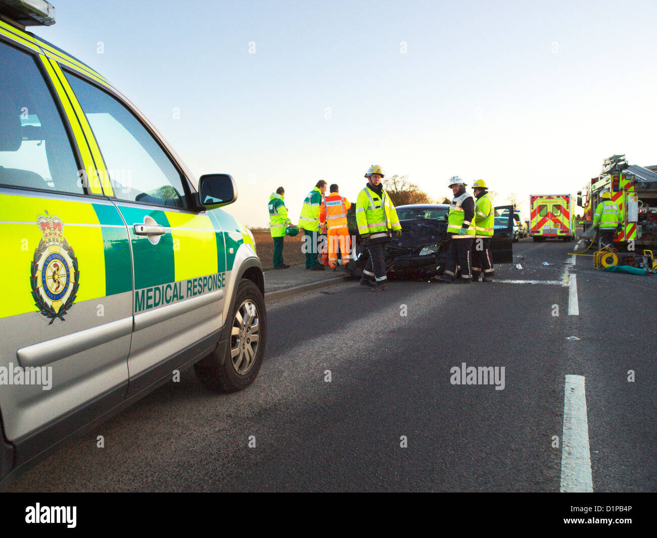 East Anglian Air Ambulance & medical response making a call at a road traffic accident in Norfolk with other - Stock Image