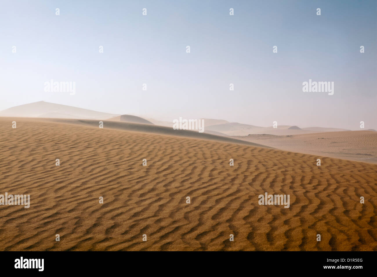 Morocco, M'Hamid, Erg Chigaga sand dunes. Sahara desert. Sand storm. - Stock Image