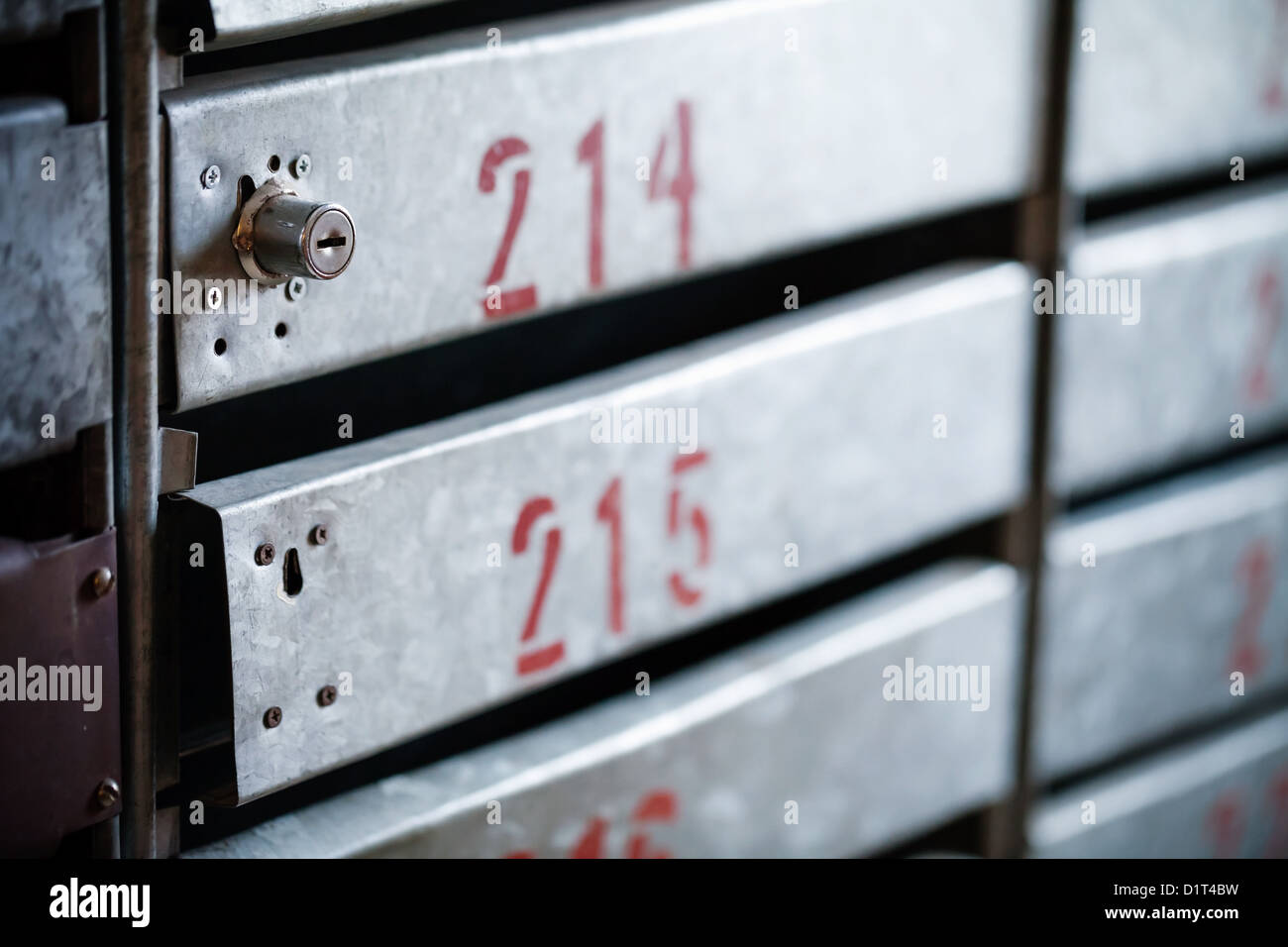 Old iron postboxes with locks and red apartment numbers Stock Photo