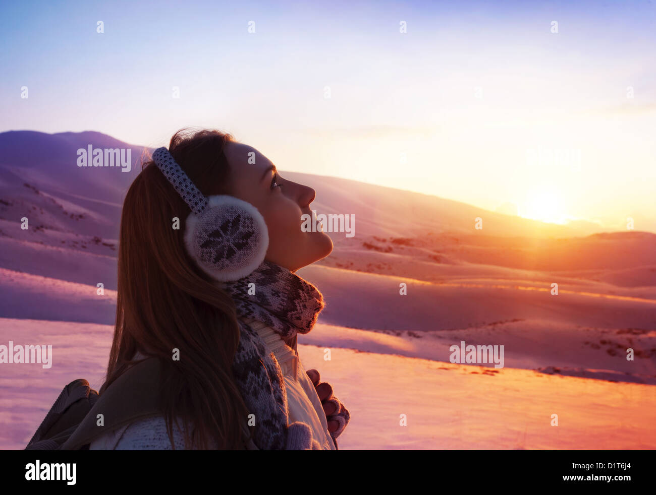 Image of pretty woman walking in snowy mountains, side view of cute girl looking up, closeup portrait of female - Stock Image