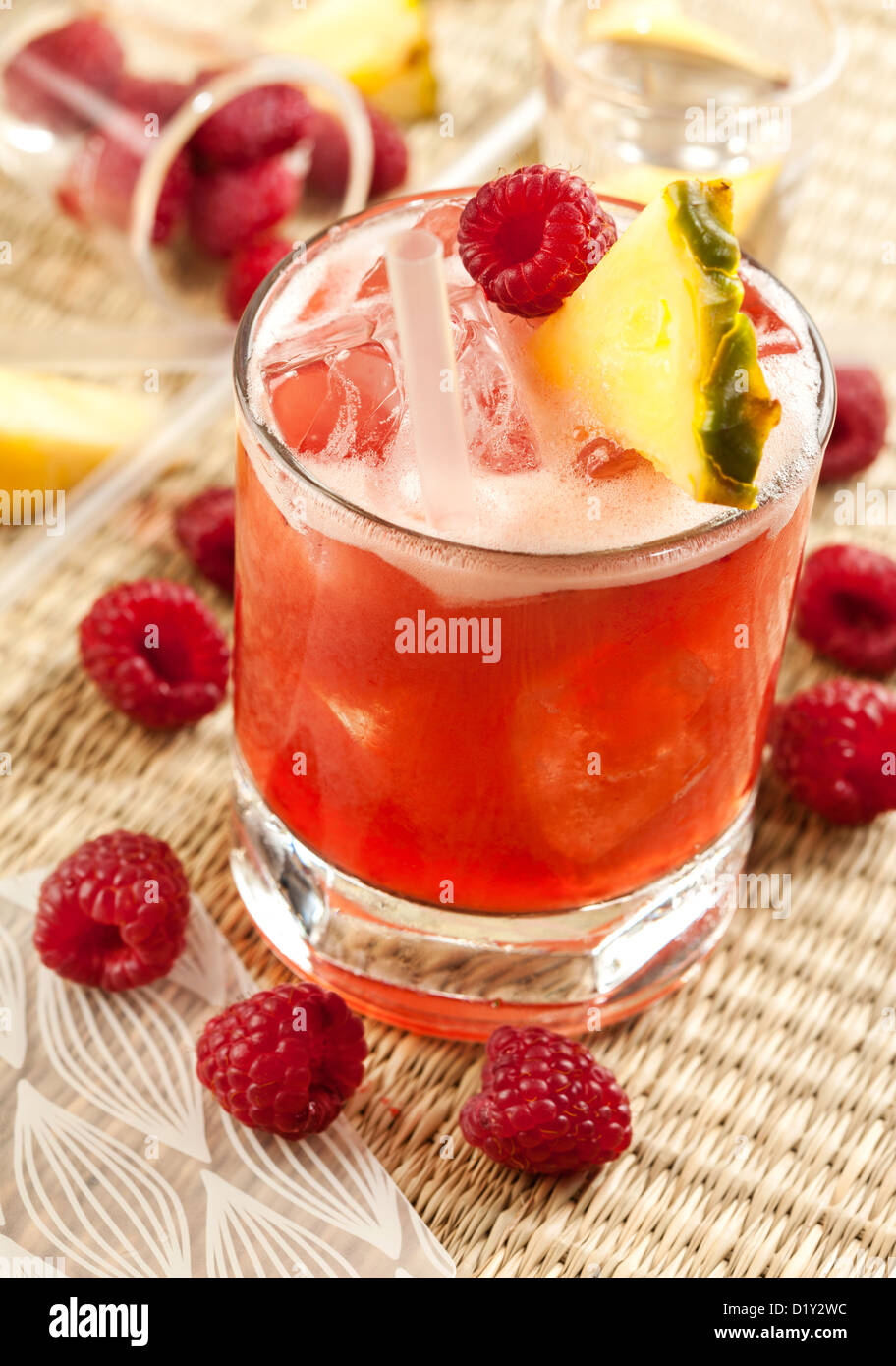 Drink with raspberry, pineapple and peach - Stock Image